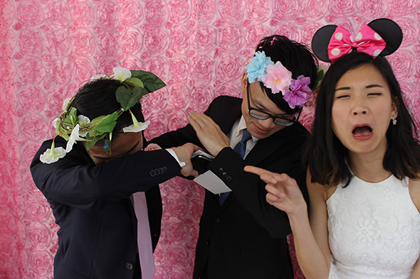Open Photo Booth with Pink Rosette Backdrop